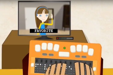 "Cartoons. Subtitle on a tv screen: ""Favorite.""  A Braille display in front of the TV."
