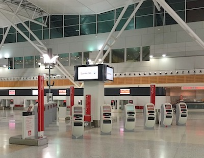 Row of airline kiosks at an airport